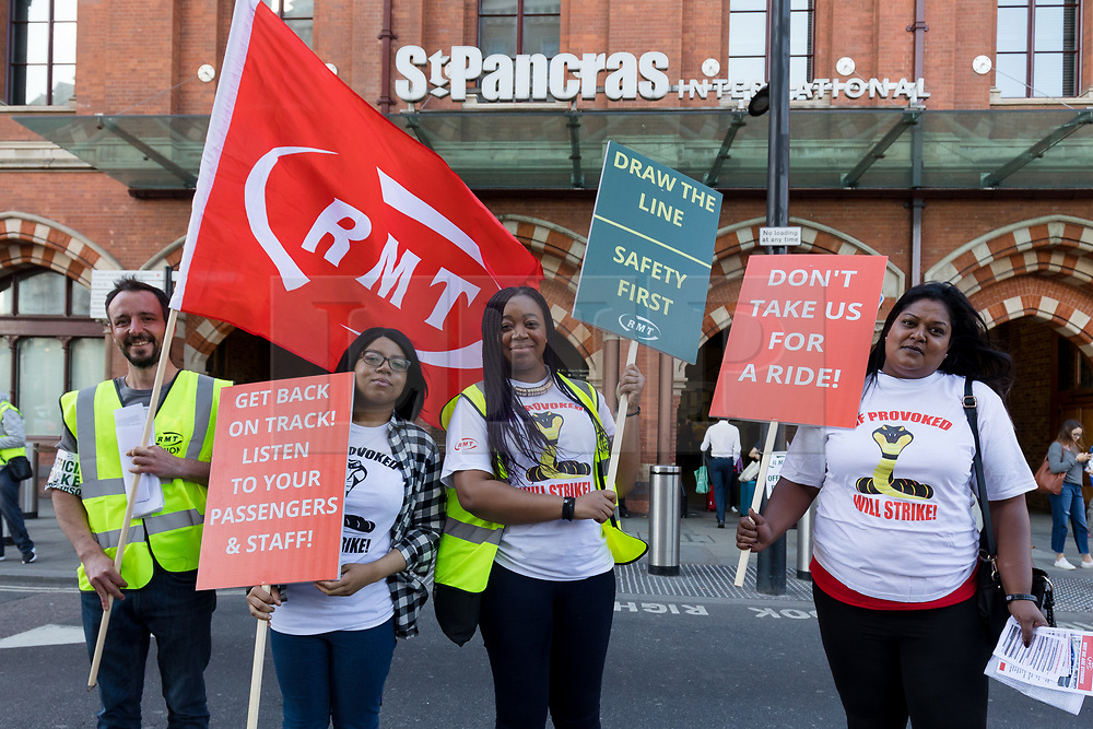 © Licensed to London News Pictures. 28/07/2018. London, UK.  Members of the National Union of Rail, Maritime and Transport Workers (RMT) stage a Eurostar strike protest outside St Pancras station in London this morning. RMT union members at Eurostar say they face dangerous overcrowding at London's St Pancras station. Photo credit: Vickie Flores/LNP