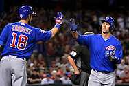 PHOENIX, ARIZONA - APRIL 08:  David Ross #3 of the Chicago Cubs is congratulated by teammate Ben Zobrist #18 after Jason Heyward (not pictured) drew a walk in the third inning during the game against the Arizona Diamondbacks at Chase Field on April 8, 2016 in Phoenix, Arizona.  (Photo by Jennifer Stewart/Getty Images)