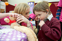23/01/2014 Max Comer from scoil Iognaid  brought his teddy with the broken neck to the Teddy Bear Hospital at NUI, Galway where Medical Students got used to dealing with Children and Kids get used to the Hospital procedures. He was seen been Aisling Bell from Galway. Photo:Andrew Downes
