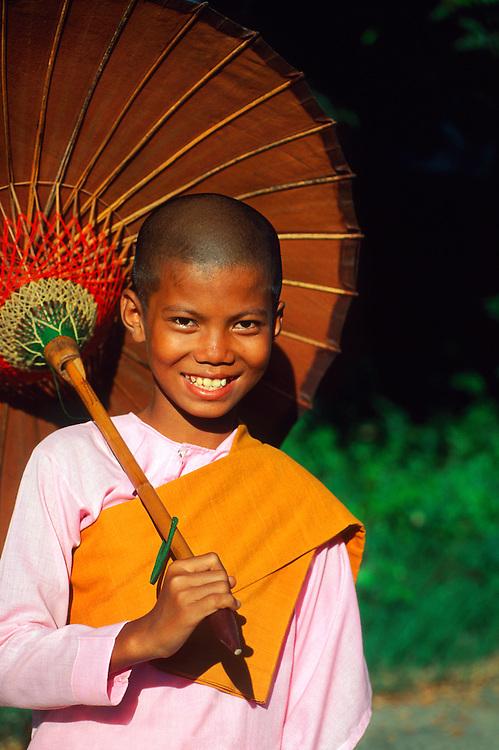 Young Buddhist nun near the Shwenandaw Kyaung Monastery, Mandalay, Myanmar (Burma)