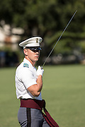 A member of the Citadel Military College corps of cadets sword salute during the first Friday Dress Parade on September 6, 2013 in Charleston, South Carolina. The Friday Dress Parade is a tradition at the Citadel going back to 1843.