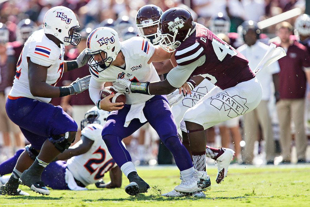 STARKVILLE, MS - SEPTEMBER 19:  J.D Almond #5 of the Northwestern State Demons is sacked by Dezmond Harris #47 of the Mississippi State Bulldogs at Davis Wade Stadium on September 19, 2015 in Starkville, Mississippi.  (Photo by Wesley Hitt/Getty Images) *** Local Caption *** J.D. Almond; Dezmond Harris