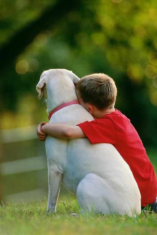 NJ, Morris County, boy hugging dog
