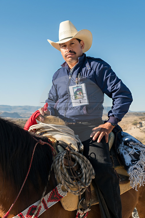 A Mexican cowboy wears a badge signifying his position as a leader of the annual Cabalgata de Cristo Rey cowboy pilgrimage January 4, 2017 in Guanajuato, Mexico. Thousands of Mexican cowboys and horse take part in the three-day ride to the mountaintop shrine of Cristo Rey.
