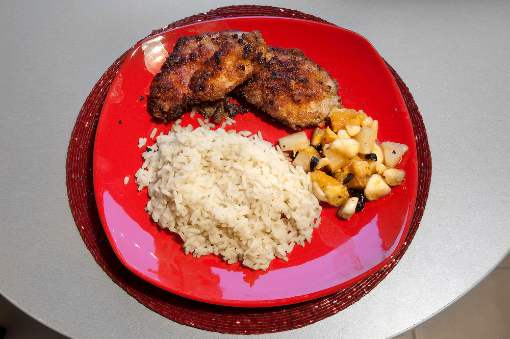 Schabowy kotlet &ndash; Pork cutlets <br /> Serves 1<br /> <br /> Ingredients: 100gr of pork in two slices <br /> 3 cups of cornflakes <br /> 1 egg <br /> pinch of salt <br /> pinch of pepper <br /> 1 banana <br /> 1 orange<br /> 1 teaspoon honey<br /> 1 teaspoon soya sauce <br /> 1 tin &ndash; 500gr pineapple<br /> 1 tablespoon walnut preserve  <br /> 3 tablespoons of extra virgin oil <br /> <br /> <br /> Preparation :<br /> 1.Crumble the cornflakes <br /> 2.Mix the egg with the pineapple juice from the tin <br /> 3.Put the meat in the egg <br /> 4.Spread &frac12; teaspoon of honey on each slice of pork <br /> 5.Bread the meat with the cornflakes and add 3-4 drops of soya sauce <br /> 6.Cut the pineapple, the orange and the banana in small pieces and mix them with the walnut sauce <br /> 7.Heat the oil in a fry pan and fry the cutlets for 7mins <br /> 8.When the cutlets are done reduce the heat, add the fruit and simmer for 2-3mins <br /> <br /> Rice <br /> Serves 1 <br /> <br /> Ingredients: 1 sac of parboiled rice <br /> <br /> Preparation :<br /> 1.Put the sac in saucepan with plenty of boiling water <br /> 2.Boil for 18mins