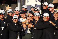 winning Team USA with the trophy at the presentation<br /> Captain Davis Love III <br /> Jordan Spieth<br /> Patrick Reed<br /> Phil Mickelson<br /> Rickie Fowler<br /> Jimmy Walker<br /> Zach Johnson<br /> Dustin Johnson<br /> Matt Kuchar<br /> J.B. Holmes<br /> Ryan Moore<br /> Brooks Koepka<br /> Brandt Snedeker<br /> after winning 17 to 11 points<br /> Sunday singles matches on the final day at the Ryder Cup 2016