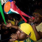 Date: 6/11/10..Fans blow vuvuzelas while watching the 2010 World Cup opening Group A match between South Africa and Mexico at Madiba, a South African restaurant in Fort Greene, Brooklyn on June 11, 2010.   The game finished in a 1-1 tie. ..Photo by Angela Jimenez for Newsweek .photographer contact 917-586-0916/angelajime@gmail.com