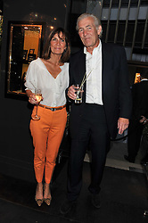 GEOFF and EMMA GOAD at a private view of jewellery and photographs by Rosie Emerson and Annoushka Ducas entitled Alchemy in association with Ruinart Champagne held at Annoushka, 41 Cadogan gardens, London SW3 on 15th September 2011.