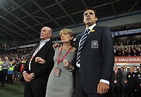 Football - International Friendly Gary Speed Memorial Match - Wales vs. Costa Rica<br /> Wales new manager Chris Coleman stands with Gary Speed's parents Carol and Roger Speed before kick off at the Cardiff City Stadium