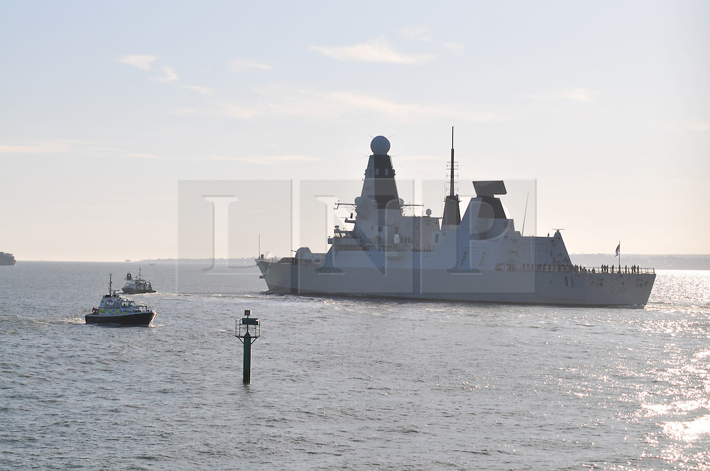 Licensed to London News Pictures. 11/01/2012. Portsmouth, UK. New Royal Navy destroyer - HMS Daring leaving Royal Navy Base in Portsmouth for it's deployment to Middle East on January 11th, 2012. Photo credit: Christopher Gretkus/LNP