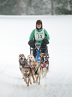 Cathy MacKay of New York heads out through Laconia Country Club Friday morning during the six dog class race at the 84th Annual Laconia World Championship Sled Dog Derby.  (Karen Bobotas/for the Laconia Daily Sun)