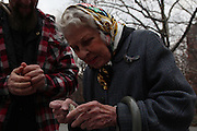 Manhattan, NY. Dec. 4, 2013. Ricky Syers heads to Washington Square Park to work, where he makes money showing his marionettes to passersby. Here Ricky gives a pin that he fixed to Doris. Ricky loves making and fixing things with his hands. Doris is a regular in Washington Square Park and she too, has a marionette made based on her. 12042013. Photo by Kayle Hope Schnell/CUNY Photo Wire