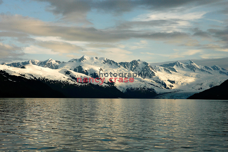 A view of snowy mountains on a cruise on Prince William Sound out of Whitter, Alaska, in July.  ..