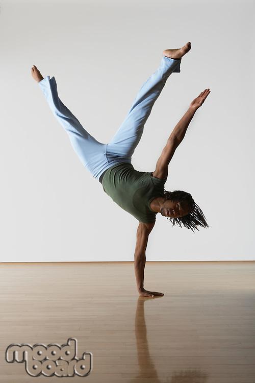 Ballet Dancer on one hand