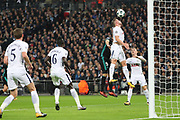 Tottenham Hostpur defender Toby Alderweireld (4) heading clear from Real Madrid striker Karim Benzema (9) during the Champions League match between Tottenham Hotspur and Real Madrid at Wembley Stadium, London, England on 1 November 2017. Photo by Matthew Redman.