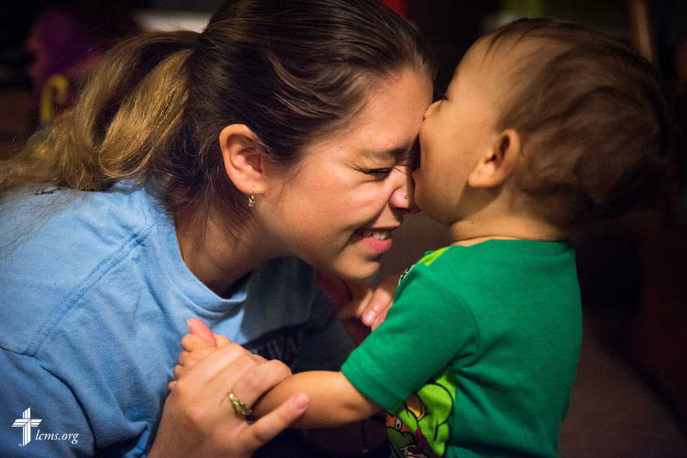 Resident and expectant mother Tiffany Busse nuzzles her son Ezekiel Vela during evening playtime at A Place of Refuge on Tuesday, Sept. 1, 2015, in Milwaukee, Wis. LCMS Communications/Erik M. Lunsford