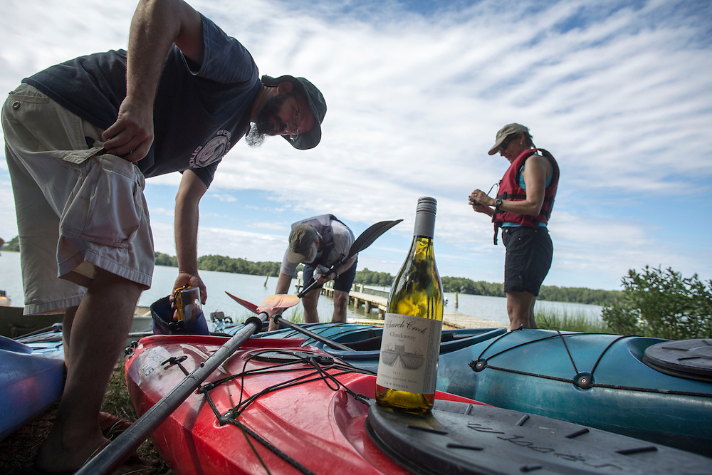MACHIPONGO, VA - JUNE 22: Tour leader Ethan Watkins, left, and kayakers John White, center, and Bonnie Wyckoff, right, prepare to depart Chatham Vineyards on Sunday, June 22nd, 2014 near Machipongo, Va. (Photo by Jay Westcott/For The Washington Post)
