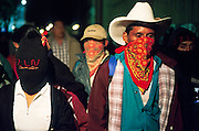 FEB 24, 2001 - SAN CRISTOBAL DE LAS CASAS, CHIAPAS, MEXICO: Members of  the EZLN (Zapatistas) participate in a march through San Cristobal de las Casas, Chiapas, Mexico, during a pro-Zapatista rally, Feb. 24, 2001. The rally was to mark the beginning of the Zapatista's march from San Cristobal de las Casas to Mexico City. The Zapatistas went to Mexico City to press their demands for the passage of the San Andres Accords, signed between the Zapatistas and the Mexican government in 1996 but stalled in the Mexican congress by the formerly ruling Institutional Revolutionary Party.  © Jack Kurtz   INDIGENOUS   POVERTY   CIVIL RIGHTS  HUMAN RIGHTS  GLOBALIZATION  WAR    VIOLENCE