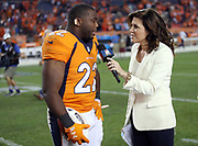 Denver Broncos running back C.J. Anderson (22) talks to NBC Sports sideline reporter Michele Tafoya after rushing for two fourth quarter touchdowns that give the Broncos a one point margin of victory after the 2016 NFL week 1 regular season football game against the Carolina Panthers on Thursday, Sept. 8, 2016 in Denver. The Broncos won the game 21-20. (©Paul Anthony Spinelli)