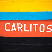 The Carlitos, a small wooden boat, brighly painted, on display in the Museum de Marinha's barge gallery. The Museu de Marinha (Maritime Museum of Navy Museum) focuses on Portuguese maritime history. It features exhibits on Portugal's Age of Discovery, the Portuguese Navy, commercial and recreational shipping, and, in a large annex, barges and seaplanes. Located in the Belem neighborhood of Lisbon, it occupies, in part, one wing of the Jerónimos Monastery. Its entrance is through a chapel that Henry the Navigator had built as the place where departing voyagers took mass before setting sail. The museum has occupied its present space since 1963.