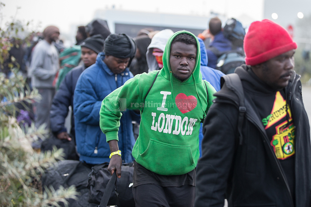 October 24, 2016 - Calais, Calais, France - Calais , France . Thousands of migrants queue as they are evacuated from the Jungle migrant camp in Calais , Northern France , on the day of a planned eviction and start of the destruction of the camp  (Credit Image: © Joel Goodman/London News Pictures via ZUMA Wire)