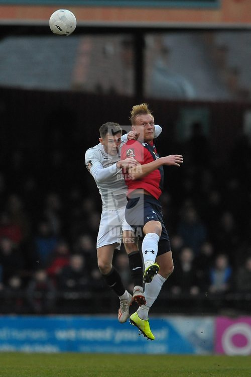 TELFORD COPYRIGHT MIKE SHERIDAN Arlen Birch of Telford and Jordan Burrow battle for the ball  during the Vanarama Conference North fixture between AFC Telford United and York City at Bootham Crescent on Saturday, January 11, 2020.<br /> <br /> Picture credit: Mike Sheridan/Ultrapress<br /> <br /> MS201920-040