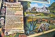 A mural painted on a building celebrating the history of Angangueo, Michoacan, Mexico. Angangueo is a tiny, remote mountain town and the entry point to the Sierra Chincua Monarch Butterfly Sanctuary.