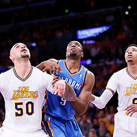 09 March 2014: Los Angeles Lakers center Robert Sacre (50) vies for the rebound with Oklahoma City Thunder power forward Serge Ibaka (9) next to Los Angeles Lakers shooting guard Kent Bazemore (6) during the Los Angeles Lakers 114-110 victory over the Oklahoma City Thunder at the Staples Center, Los Angeles, California, USA.