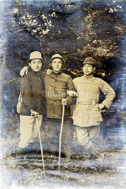 vintage fading portrait of three men on a hiking trip Japan early 1900s