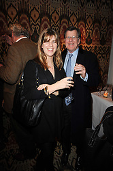 KATE ELLIOT and her father SIMON ELLIOT at the opening of Luke Irwin's showroom at 22 Pimlico Road, London SW1 on 24th November 2010.