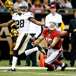Sep 22, 2013; New Orleans, LA, USA; Arizona Cardinals wide receiver Michael Floyd (15) is unable to make a reception as New Orleans Saints cornerback Keenan Lewis (28) defends during the first half of a game at Mercedes-Benz Superdome. Mandatory Credit: Derick E. Hingle-USA TODAY Sports