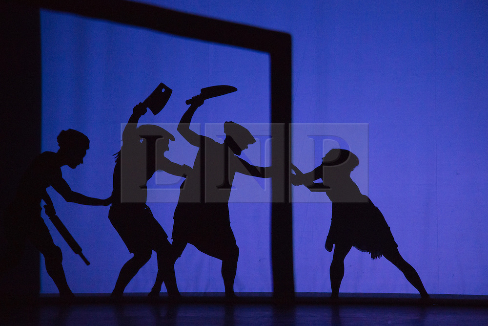 "© Licensed to London News Pictures. 12 March 2014. London, England. Pictured: Scene ""Chefs"". Pilobolus dance troupe presents ""Shadowland"", a show part dance, part circus, part concert utilising multiple moving screens. ""Shadowland"" is performed for the first time in the UK. Created in collaboration with Steven Banks and featuring a score by David Poe, the show will run from 11 March to 30 March 2014 at the Peacock Theatre, London. Photo credit: Bettina Strenske/LNP"