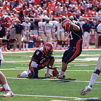 Illinois Miles Osei #8 holds the ball for Nick Immekus #37 for a kick downfield during the Illinois Charleston Southern game at Memorial Stadium