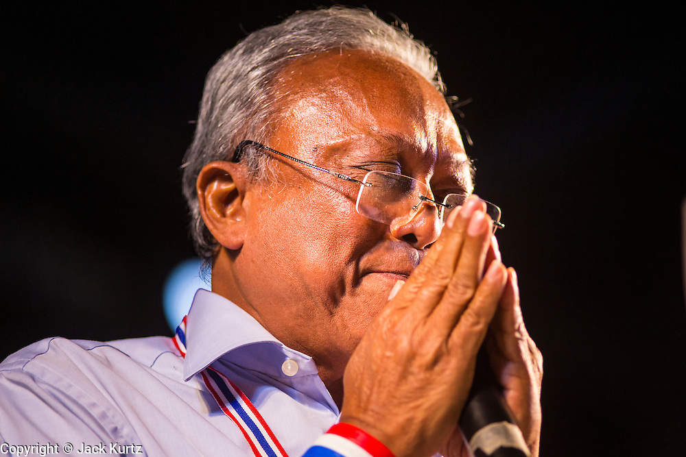 24 JANUARY 2014 - BANGKOK, THAILAND: SUTHEP THAUGSUBAN on stage at the Shutdown Bangkok Pathum Wan site. Shutdown Bangkok has been going for 12 days with no resolution in sight. Suthep, the leader of the anti-government protests and the People's Democratic Reform Committee (PDRC), the umbrella organization of the protests,  is still demanding the caretaker government of Prime Minister Yingluck Shinawatra resign, the PM says she won't resign and intends to go ahead with the election.    PHOTO BY JACK KURTZ