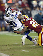 Dallas Cowboys running back Darren McFadden (20) pushes through a tackle attempt by Washington Redskins cornerback DeAngelo Hall (23) as he runs for a 6 yard late fourth quarter touchdown that gives the Cowboys a 16-9 lead during the 2015 week 13 regular season NFL football game against the Washington Redskins on Monday, Dec. 7, 2015 in Landover, Md. The Cowboys won the game 19-16. (©Paul Anthony Spinelli)