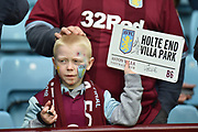 A small boy with a Villa placard waits for autographs during the EFL Sky Bet Championship match between Aston Villa and Middlesbrough at Villa Park, Birmingham, England on 16 March 2019.
