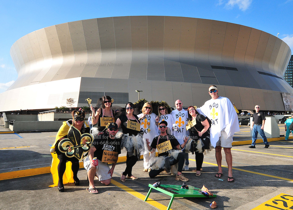 """The New Orleans Saints fans dress up as """"Boo Dat's and Who Dat's Fairy's for Halloween in hopes of beating the Pittsburgh Steelers at the SuperDome Sunday Oct. 31,2010. The Guiness Book of World Records is attempting to set a record for the most people in costume at the Super Dome on Halloween.The Saints play the Pittsburgh Steelers in prime time on NBC in New Orleans at the SuperDome in Louisiana on Halloween Oct.31 2010. Big Ben Roethlisberger of the Pittsburg Steelers arrives at  the SuperDome in New Orleans on Halloween night to play the New Orleans Saints.Photo©SuziAltman."""