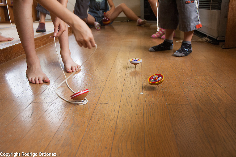 Children play with spinning tops at a child care center (gakudo) in Rikuzentakata, Japan.