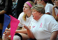 """6 Oct. 2011 -- ST. LOUIS. --  Rosati-Kain High School president Sister Joan Andert (right), SSND, talks with Kougars volleyball player Lydia Ely (left) before Rosati-Kain met Bishop DuBourg High School in a """"pink game"""" to benefit SSM St. Mary's Health Care Center's Cancer Care at DuBourg in St. Louis Oct. 6, 2011. The even honored Sister Andert, who is currently undergoing treatment for breast cancer. Photo © copyright 2011 Sid Hastings."""