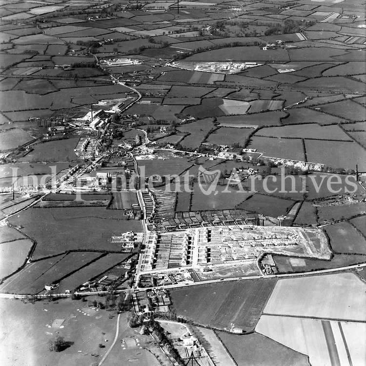 A118 Clondalkin. Source E.H. 09/10/57 (Part of the Independent Newspapers Ireland/NLI collection.)<br /> <br /> <br /> These aerial views of Ireland from the Morgan Collection were taken during the mid-1950's, comprising medium and low altitude black-and-white birds-eye views of places and events, many of which were commissioned by clients. From 1951 to 1958 a different aerial picture was published each Friday in the Irish Independent in a series called, 'Views from the Air'.<br /> The photographer was Alexander 'Monkey' Campbell Morgan (1919-1958). Born in London and part of the Royal Artillery Air Corps, on leaving the army he started Aerophotos in Ireland. He was killed when, on business, his plane crashed flying from Shannon.