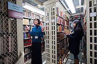 Boston Athenaeum Director Lizzie Barker leads a tour through the stacks in Boston's Beacon Hill.