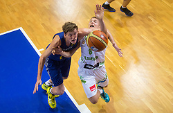 Artem Pustovoy of Ukraine bs Edo Muric of Slovenia during friendly match between National teams of Slovenia and Ukraine for Eurobasket 2013 on July 26, 2013 in Dvorana Komunalnega centra, Domzale, Slovenia. (Photo by Vid Ponikvar / Sportida.com)