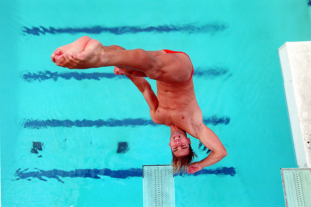 David Pichler does a dive off the 3-meter springboard during practice at the University of Miami in Coral Gables, Florida