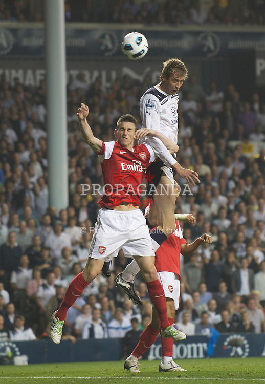 LONDON, ENGLAND - Wednesday, April 20, 2011: Tottenham Hotspur's Peter Crouch and Arsenal's Laurent Koscieiny during the Premiership match at White Hart Lane. (Photo by David Rawcliffe/Propaganda)