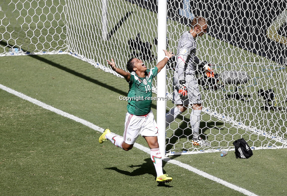 29.06.2014. Fortaleza, Brazil. Mexicos Giovani dos Santos(L) celebrates scoring the games opening goal during a Round of 16 match between Netherlands and Mexico of 2014 FIFA World Cup at the Estadio Castelao Stadium in Fortaleza, Brazil, on June 29,