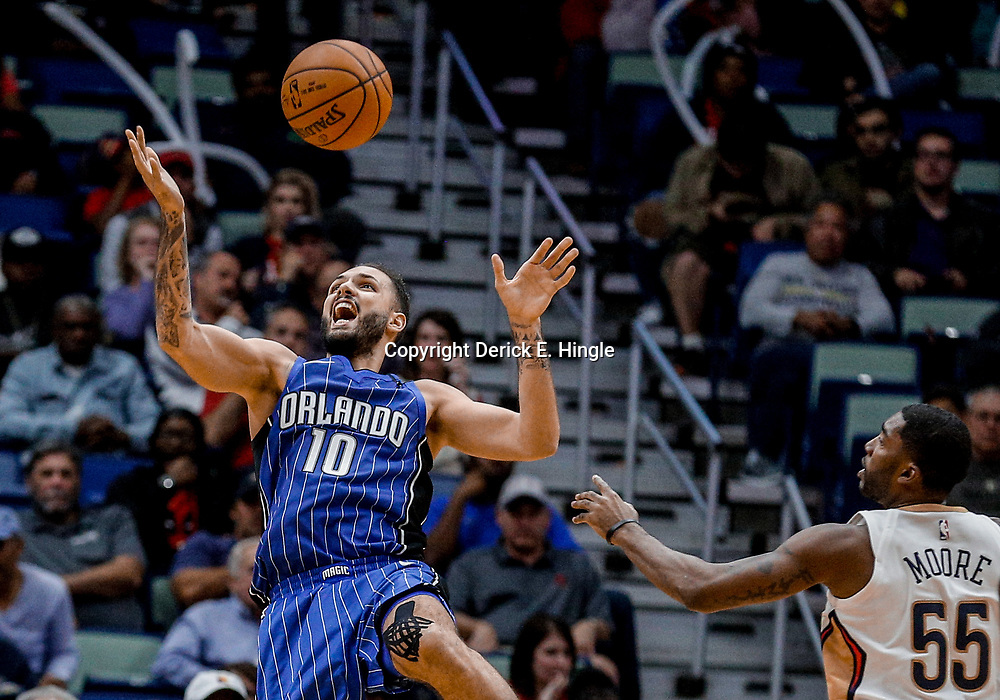 Oct 30, 2017; New Orleans, LA, USA; Orlando Magic guard Evan Fournier (10) looses the ball as New Orleans Pelicans guard E'Twaun Moore (55) defends during the second half of a game at the Smoothie King Center. The Magic defeated the Pelican 115-99. Mandatory Credit: Derick E. Hingle-USA TODAY Sports