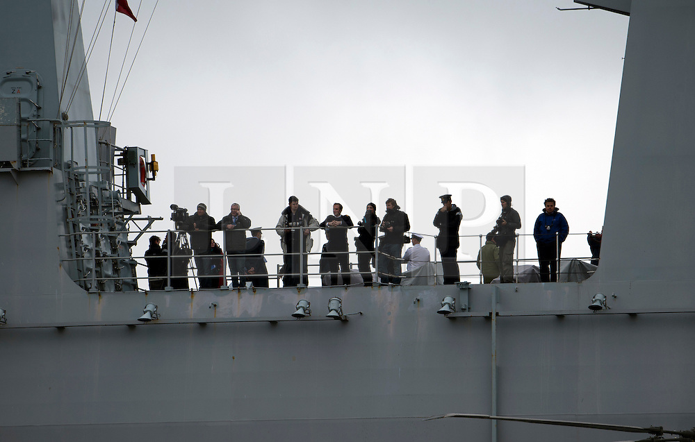 © London News Pictures. 04/05/2012. London, UK. Crew and media on board Royal Navy helicopter carrier HMS Ocean as it passes woolwich pier towards Greenwich for an Olympics security exercise as part of operation Olympic Guardian on May 4, 2012. The ship will be berthed at Greenwich throughout the Olympics, acting as logistic hub and helicopter launch platform. Photo credit: Ben Cawthra/LNP