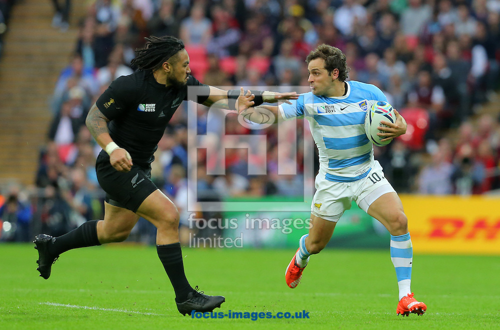 Ma'a Nonu of New Zealand attempts to challenge Nicolas Sanchez of Argentina during the 2015 Rugby World Cup match at Wembley Stadium, London<br /> Picture by Paul Terry/Focus Images Ltd +44 7545 642257<br /> 20/09/2015