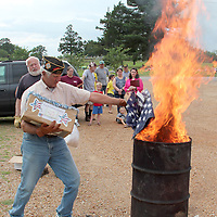 (Floyd Ingram / Buy at photos.chickasawjournal.com)<br /> Frank Pemper carefully drops American Flags in a bin to be burned at the annual Flag Retirement Ceremony on Flag Day, June 14, 2016. More than two dozen parents, grandparents and children turned out for Tuesday's event at Joe Brigance Park.