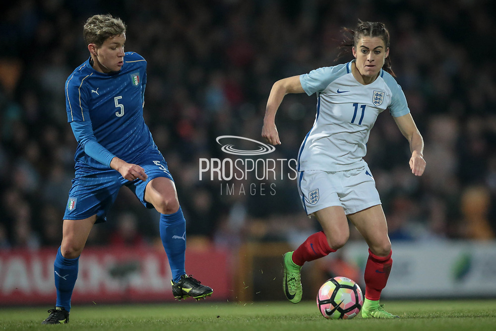 Karen Carney (England) (Chelsea) and Elena Linari (Italy) (Darl Fiorentina) during the Women's International Friendly match between England Ladies and Italy Women at Vale Park, Burslem, England on 7 April 2017. Photo by Mark P Doherty.